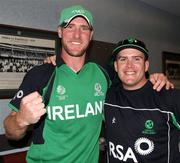 2 March 2011; Ireland's John Mooney, left, and team-mate Will Lintern celebrate after their side's victory over England. 2011 ICC Cricket World Cup, hosted by India, Sri Lanka and Bangladesh, Bangalore, India. Picture credit: Barry Chambers / Cricket Ireland / SPORTSFILE