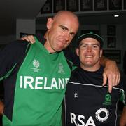 2 March 2011; Ireland's Trent Johnson, left, and team-mate Will Lintern celebrate after their side's victory over England. 2011 ICC Cricket World Cup, hosted by India, Sri Lanka and Bangladesh, Bangalore, India. Picture credit: Barry Chambers / Cricket Ireland / SPORTSFILE
