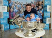 18 October 2016; AIG Insurance, proud sponsor of Dublin GAA, held a reception at its offices today to mark the Dublin football team's All-Ireland success. Pictured is Bernard Brogan of Dublin with Emily Dunn, age 6 weeks, and Adam Canavan, age 4 month, in the Sam Maguire cup. For more information about AIG Insurance's products and services go to www.aig.ie or call 1890 50 27 27. AIG Offices in North Wall Quay, Dublin. Photo by Cody Glenn/Sportsfile