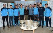 18 October 2016; AIG Insurance, proud sponsor of Dublin GAA, held a reception at its offices today to mark the Dublin football team's All-Ireland success. Pictured are, from left, Dublin players James McCarthy, David Byrne, Bernard Brogan, Michael Fitzsimons, with members of the AIG Gen WHY Team Aisling Fox and David Neil, Cian O'Sullivan, Paul Flynn and Colm Basquell, with the Sam Maguire cup. For more information about AIG Insurance's products and services go to www.aig.ie or call 1890 50 27 27. AIG Offices in North Wall Quay, Dublin. Photo by Cody Glenn/Sportsfile