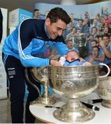 18 October 2016; AIG Insurance, proud sponsor of Dublin GAA, held a reception at its offices today to mark the Dublin football team's All-Ireland success. Pictured is Bernard Brogan of Dublin with Emily Dunn, age 6 weeks, from Blackrock, Co Dublin. For more information about AIG Insurance's products and services go to www.aig.ie or call 1890 50 27 27. AIG Offices in North Wall Quay, Dublin. Photo by Cody Glenn/Sportsfile