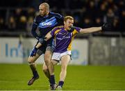 19 October 2016; Paul Cunningham of St Jude's tussles with Mark Vaughan of Kilmacud Crokes during the Dublin County Senior Club Football Championship Quarter-Final match between St Jude's and Kilmacud Crokes at Parnell Park in Dublin. Photo by Piaras Ó Mídheach/Sportsfile