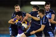 19 October 2016; Cian O'Sullivan of Kilmacud Crokes in action against St Jude's, from left, Colm Murphy, Séamus Ryan, Paul Courtney and Kieran Doherty during the Dublin County Senior Club Football Championship Quarter-Final match between St Jude's and Kilmacud Crokes at Parnell Park in Dublin. Photo by Piaras Ó Mídheach/Sportsfile