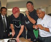 4 March 2011; Ireland's Kevin O'Brien cuts the cake to mark his 27th birthday alongside team manager Roy Torrens, right, and members of the hotel staff. 2011 ICC Cricket World Cup, hosted by India, Sri Lanka and Bangladesh, Bangalore, India. Picture credit: Barry Chambers / Cricket Ireland / SPORTSFILE