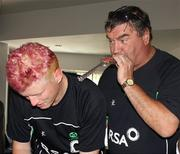 4 March 2011; Ireland manager Roy Torrens, right, blows a party whistle as Kevin O'Brien cuts the cake to mark his 27th birthday. 2011 ICC Cricket World Cup, hosted by India, Sri Lanka and Bangladesh, Bangalore, India. Picture credit: Barry Chambers / Cricket Ireland / SPORTSFILE
