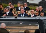 21 October 2016; Former Munster and Ireland player Mick Galwey looks on as the hearse arrives for the funeral of Munster Rugby head coach Anthony Foley at the St. Flannan's Church, Killaloe, Co Clare. The Shannon club man, with whom he won 5 All Ireland League titles, played 202 times for Munster and was capped for Ireland 62 times, died suddenly in Paris on November 16, 2016 at the age of 42. Photo by Stephen McCarthy/Sportsfile