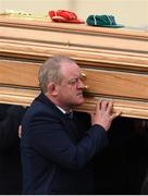 21 October 2016; Former Munster and Ireland player Mick Galwey carries the coffin of Munster Rugby head coach Anthony Foley leaves the St. Flannan's Church, Killaloe, Co Clare. The Shannon club man, with whom he won 5 All Ireland League titles, played 202 times for Munster and was capped for Ireland 62 times, died suddenly in Paris on November 16, 2016 at the age of 42. Photo by Stephen McCarthy/Sportsfile