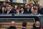 21 October 2016; Brian O'Driscoll, who captained Leinster, Ireland and the British and Irish Lions, looks on as the hearse arrives for the funeral of Munster Rugby head coach Anthony Foley at the St. Flannan's Church, Killaloe, Co Clare. The Shannon club man, with whom he won 5 All Ireland League titles, played 202 times for Munster and was capped for Ireland 62 times, died suddenly in Paris on November 16, 2016 at the age of 42. Photo by Stephen McCarthy/Sportsfile