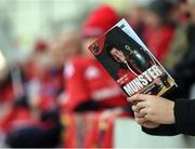 22 October 2016; A supporter reads his the match programme before the European Rugby Champions Cup Pool 1 Round 2 match between Munster and Glasgow Warriors at Thomond Park in Limerick. Photo by Diarmuid Greene/Sportsfile
