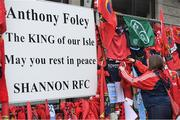 22 October 2016; A supporter adds a Munster Rugby jersey to the tribute, outside the Shannon RFC Club house, in memory of the late Munster Rugby head coach Anthony Foley before the European Rugby Champions Cup Pool 1 Round 2 match between Munster and Glasgow Warriors at Thomond Park in Limerick. The Shannon club man, with whom he won 5 All Ireland League titles, played 202 times for Munster and was capped for Ireland 62 times, died suddenly in Paris on November 16, 2016 at the age of 42. European Rugby Champions Cup Pool 1 Round 2 match between Munster and Glasgow Warriors at Thomond Park in Limerick. Photo by Brendan Moran/Sportsfile