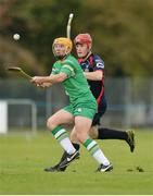 22 October 2016; Cha Dwyer of Ireland in action against Lee Bain of Scotland during the 2016 Senior Hurling/Shinty International Series match between Ireland and Scotland at Bught Park in Inverness, Scotland. Photo by Piaras Ó Mídheach/Sportsfile