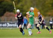 22 October 2016; Michael Breen of Ireland in action against Rory Kennedy of Scotland during the 2016 Senior Hurling/Shinty International Series match between Ireland and Scotland at Bught Park in Inverness, Scotland. Photo by Piaras Ó Mídheach/Sportsfile
