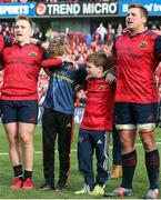 22 October 2016; The sons of the late Munster Rugby head coach Anthony Foley, Tony and Dan, along with Munster players Rory Scannell (L) and CJ Stander, sing 'Stand Up and Fight' on the pitch after the European Rugby Champions Cup Pool 1 Round 2 match between Munster and Glasgow Warriors at Thomond Park in Limerick. The Shannon club man, with whom he won 5 All Ireland League titles, played 202 times for Munster and was capped for Ireland 62 times, died suddenly in Paris on November 16, 2016 at the age of 42. Photo by Brendan Moran/Sportsfile