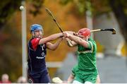22 October 2016; James Toher of Ireland in action against Liam MacDonald of Scotland during the 2016 Senior Hurling/Shinty International Series match between Ireland and Scotland at Bught Park in Inverness, Scotland. Photo by Piaras Ó Mídheach/Sportsfile