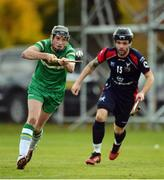 22 October 2016; Danny Cullen of Ireland in action against Daniel Cameron of Scotland during the 2016 Senior Hurling/Shinty International Series match between Ireland and Scotland at Bught Park in Inverness, Scotland. Photo by Piaras Ó Mídheach/Sportsfile