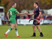 22 October 2016; Shane Dooley of Ireland shakes hands with John Barr of Scotland after the 2016 Senior Hurling/Shinty International Series match between Ireland and Scotland at Bught Park in Inverness, Scotland. Photo by Piaras Ó Mídheach/Sportsfile