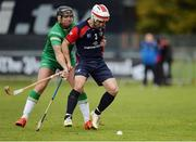 22 October 2016; Finlay MacRae of Scotland in action against Shane Dooley of Ireland during the 2016 Senior Hurling/Shinty International Series match between Ireland and Scotland at Bught Park in Inverness, Scotland. Photo by Piaras Ó Mídheach/Sportsfile