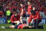 22 October 2016; Duncan Casey of Munster is attended by medical personnel before leaving the pitch with an injury during the European Rugby Champions Cup Pool 1 Round 2 match between Munster and Glasgow Warriors at Thomond Park in Limerick. Photo by Brendan Moran/Sportsfile