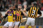 6 March 2011; John Dalton, Kilkenny, supported by Noel Hickey, 3, in action against Garrett Sinnott, Wexford. Allianz Hurling League Division 1 Round 3, Kilkenny v Wexford, Nowlan Park, Kilkenny. Picture credit: Stephen McCarthy / SPORTSFILE