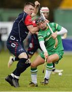 22 October 2016; David Reidy of Ireland in action against Steven MacDonald of Scotland during the 2016 Senior Hurling/Shinty International Series match between Ireland and Scotland at Bught Park in Inverness, Scotland. Photo by Piaras Ó Mídheach/Sportsfile