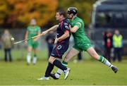 22 October 2016; Bryan Murphy of Ireland in action against Glen Mackintosh of Scotland during the 2016 Senior Hurling/Shinty International Series match between Ireland and Scotland at Bught Park in Inverness, Scotland. Photo by Piaras Ó Mídheach/Sportsfile