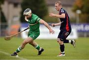 22 October 2016; Mickey Burke of Ireland in action against Kevin Bartlett of Scotland during the 2016 Senior Hurling/Shinty International Series match between Ireland and Scotland at Bught Park in Inverness, Scotland. Photo by Piaras Ó Mídheach/Sportsfile