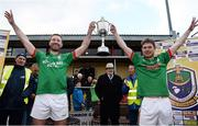 23 October 2016; Captains Darragh Donnelly, left, and Cathal McHugh of St Brigid's lift the trophy following their side's victory during the Roscommon County Senior Club Football Championship Final game between St Brigid's and Padraig Pearses in Kiltoom, Roscommon. Photo by Seb Daly/Sportsfile