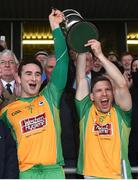23 October 2016; Corofin's Alan Burke, left, and Ciaran McGrath of Corofin lift the cup following their victory in the Galway County Senior Club Football Championship Final match between Corofin and Salthill-Knocknacarra at Pearse Stadium in Galway. Photo by Ramsey Cardy/Sportsfile