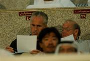 31 October 200; Republic of Ireland manager, Mick McCarthy, checks his notes alongside Eddie Corcoran, Liason officer FAI, during the FIFA World Cup AFC Preliminary Competition 2nd round , Al Wahda stadium, Abu Dhabi, United Arab Emirates. United Arab Emirates v Iran. Soccer. Picture credit; David Maher / SPORTSFILE *EDI*
