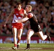 8 July 2001; Tadhg Kennelly, Sydney Swans in action against Scott Freeborn, Carlton.  Sydney Swans v Carlton, Australian Football League, Sydney Cricket Ground, New South Wales, Australia. Picture Credit; Matt Browne / SPORTSFILE