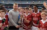 26 October 2016;  Scoil an Chroí Ró Naofa Íosa, Huntstown, captain Evan Kearney is presented with the cup by Kilkenny hurler Richie Hogan after beating St. Kevin's BNS, Kilnamanagh, in the Corn Chlanna Gael final during the Allianz Cumann na mBunscol Finals at Croke Park in Dublin. Photo by Piaras Ó Mídheach/Sportsfile