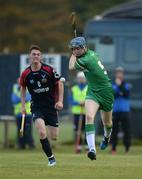 22 October 2016; Tom Fox of Ireland in action against Barry MacDonald of Scotland during the 2016 U21 Hurling/Shinty International Series match between Ireland and Scotland at Bught Park in Inverness, Scotland. Photo by Piaras Ó Mídheach/Sportsfile