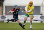 22 October 2016; Enda Rowland of Ireland in action against Will Cowie of Scotland during the 2016 U21 Hurling/Shinty International Series match between Ireland and Scotland at Bught Park in Inverness, Scotland. Photo by Piaras Ó Mídheach/Sportsfile