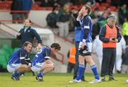 13 March 2011; Cavan players, from left to right, Gareth Smith, Dane O'Dowd, David Givney and joint manager Val Andrews show their disappointment after defeat to Limerick. Allianz Football League, Division 3, Round 4, Limerick v Cavan, Gaelic Grounds, Limerick. Picture credit: Diarmuid Greene / SPORTSFILE