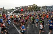30 October 2016; Runners pass James Joyce bridge during the SSE Airtricity Dublin Marathon 2016 in Dublin City. 19,500 runners took to the Fitzwilliam Square start line to participate in the 37th running of the SSE Airtricity Dublin Marathon, making it the fourth largest marathon in Europe. Photo by Seb Daly/Sportsfile