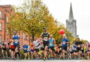 30 October 2016; Runners pass St Patricks Cathedral during the SSE Airtricity Dublin Marathon 2016 in Dublin. 19,500 runners took to the Fitzwilliam Square start line to participate in the 37th running of the SSE Airtricity Dublin Marathon, making it the fourth largest marathon in Europe. Photo by Ramsey Cardy/Sportsfile