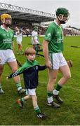 30 October 2016; Henry Shefflin of Ballyhale Shamrocks and his son Henry jnr in the parade prior to the Kilkenny County Senior Club Hurling Championship Final game between Ballyhale Shamrocks and O'Loughlin Gaels at Nowlan Park in Kilkenny. Photo by Piaras Ó Mídheach/Sportsfile