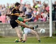 30 October 2016; Brian Looney of Dr. Crokes in action against Martin McMahon of Kilmurry Ibrickane during the AIB Munster GAA Football Senior Club Championship quarter-final game between Kilmurry Ibrickane and Dr. Crokes in Quilty, Co. Clare. Photo by Diarmuid Greene/Sportsfile