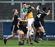 30 October 2016; Christopher McMonigle of Glenswilly in action against Gerard McEvoy, Aaron Branagan and Niall Branagan of Kilcoo during the AIB Ulster GAA Football Senior Club Championship quarter-final game between Kilcoo and Glenswilly at Pairc Esler, Newry, Co. Down. Photo by Oliver McVeigh/Sportsfile