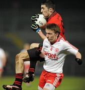 16 March 2011; Keith Quinn, Down, in action against Ryan Pickering, Tyrone. Cadbury Ulster GAA Football Under 21 Championship Quarter-Final, Down v Tyrone, Pairc Esler, Newry, Co. Down. Picture credit: Oliver McVeigh / SPORTSFILE