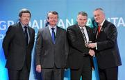 16 March 2011; John Joe Brady, Mullahoran, Co. Cavan, is presented with his GAA President's Award for 2011 by Uachtarán Cumann Lúthchleas Gael Criostóir Ó Cuana, in the company of AIB Bank General Manager Billy Finn, left, and Pól Ó Gallchóir, Ceannaái TG4. John Joe Brady's association with Ladies Football goes back to 1976 and he has held practically all the positions of administration and management of football teams. John Joe was the first Chairman of the Mullahoran Club in the years 1975 and 1982 and from 1995 to '99. He helped bring the Mullahoran Ladies to the top of the ladder in 1977 when they won the first ever All-Ireland Club final. GAA President's Awards 2011, Croke Park, Dublin. Picture credit: Brian Lawless / SPORTSFILE