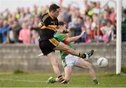 30 October 2016; Brian Looney of Dr Crokes in action against Martin McMahon of Kilmurry Ibrickane during the AIB Munster GAA Football Senior Club Championship quarter-final game between Kilmurry Ibrickane and Dr. Crokes in Quilty, Co. Clare. Photo by Diarmuid Greene/Sportsfile