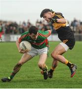 30 October 2016; Martin McMahon of Kilmurry Ibrickane in action against Micheal Burns of Dr Crokes during the AIB Munster GAA Football Senior Club Championship quarter-final game between Kilmurry Ibrickane and Dr. Crokes in Quilty, Co. Clare. Photo by Diarmuid Greene/Sportsfile