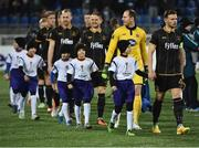 3 November 2016; Dundalk captain Andy Boyle leads the  team out for the start of the UEFA Europa League Group D Matchday 4 match between Zenit St Petersburg v Dundalk at Stadion Pertrovskiy in St Petersburg, Russia. Photo by David Maher/Sportsfile