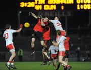 23 March 2011; Keith Quinn, Down, in action against Richard Donnelly, Tyrone. Cadbury Ulster GAA Football Under 21 Championship Quarter-Final Replay, Tyrone v Down, Healy Park, Omagh, Co. Tyrone. Picture credit: Oliver McVeigh / SPORTSFILE