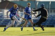 6 November 2016; Lar Corbett of Thurles Sarsfields, supported by team-mate Conor Lanigan, right, kicks wide under pressure from Kevin Sheehan of Ballyea during the AIB Munster GAA Hurling Senior Club Championship semi-final game between Ballyea and Thurles Sarsfields at Cusack Park in Ennis, Co Clare. Photo by Piaras Ó Mídheach/Sportsfile