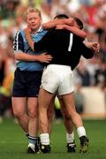 21 June1998; Kildare goalkeeper Christy Byrne celebrates with his team-mate Seamus Dowling as Dublin's Bobbie Boyle watches on following the Bank of Ireland Leinster Senior Football Championship Quarter-Final Replay match between Kildare and Dublin at Croke Park in Dublin. Photo by David Maher/Sportsfile
