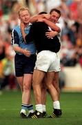 21 June 1998; Kildare goalkeeper Christy Byrne celebrates with team-mate Seamus Dowling as Dublin's Robbie Boyle watches on following the Bank of Ireland Leinster Senior Football Championship Quarter-Final Replay between Kildate and Dublin at Croke Park in Dublin. Photo by David Maher/Sportsfile