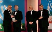 30 November 2001; Eoin Kelly, Tipperary, receives his award from An Taoiseach Bertie Ahern TD, Paul Donovan, Chief Executive, Eircell Vodafone and Sean McCague, President, Cumann Luthchleas Gael, at the Eircell Vodafone AllStar Awards at the CityWest Hotel, Dublin. Hurling. Picture credit; Ray McManus / SPORTSFILE *EDI*