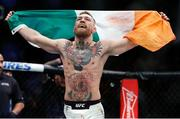 12 November 2016; Conor McGregor celebrates after defeating Eddie Alvarez by second round TKO following their lightweight title bout at UFC 205 in Madison Square Garden, New York. Photo by Adam Hunger/Sportsfile